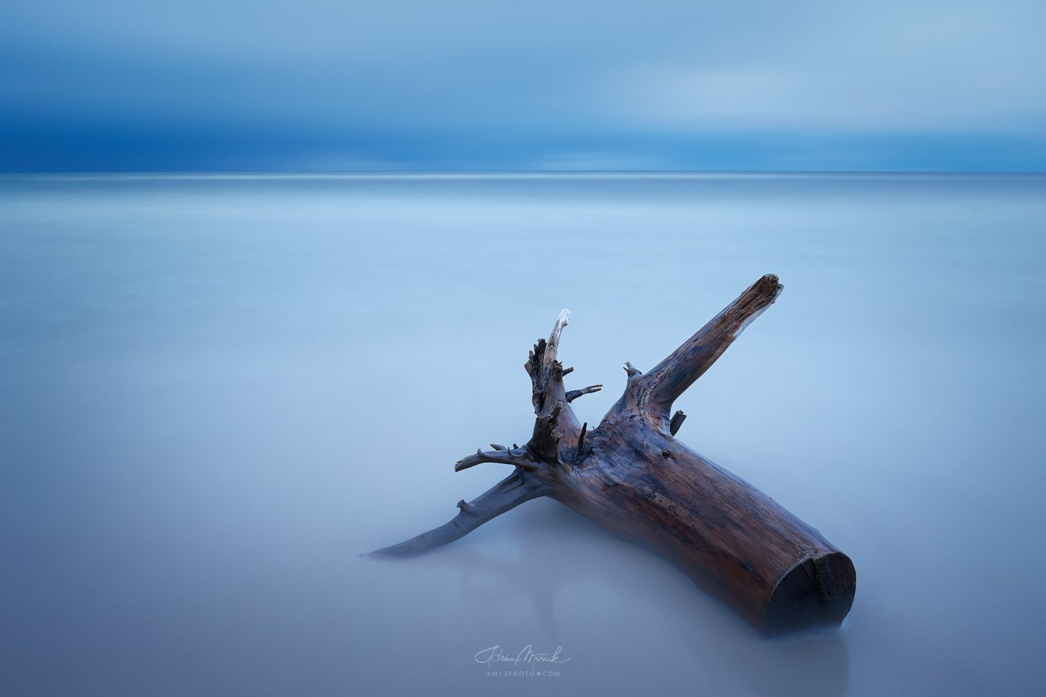 Baltic sea and stump, long exposure