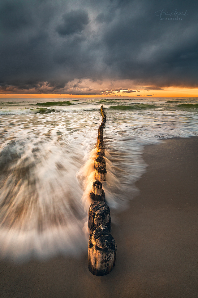 Dramatic sunset on Baltic sea coast
